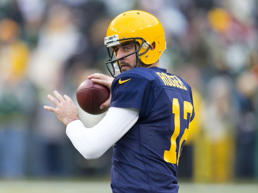 40a7c08e3 ... USA; Green Bay Packers quarterback Aaron Rodgers (12) throws a pass  during warmups prior to the game against the Philadelphia Eagles at Lambeau  Field.