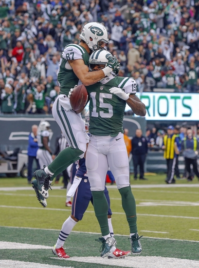... New York Jets wide receiver Eric Decker (87) celebrates third quarter  touchdown caption by wide receiver Brandon Marshall (15) against the New  England ... d9005b246