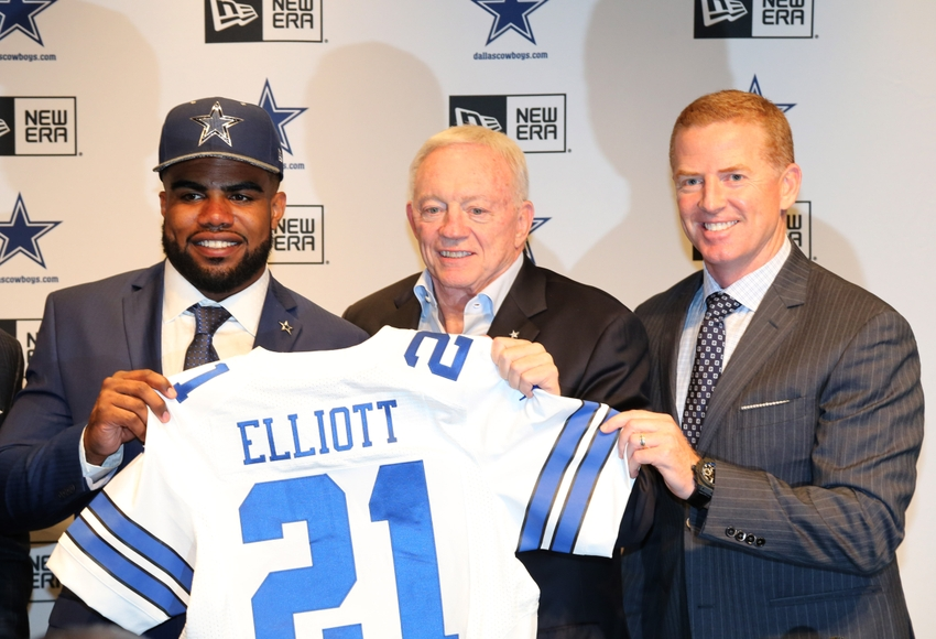 a3f338db Apr 29, 2016; Irving, TX, USA; Dallas Cowboys number one draft pick Ezekiel  Elliott answers questions with owner Jerry Jones (center) and head ooach  Jason ...