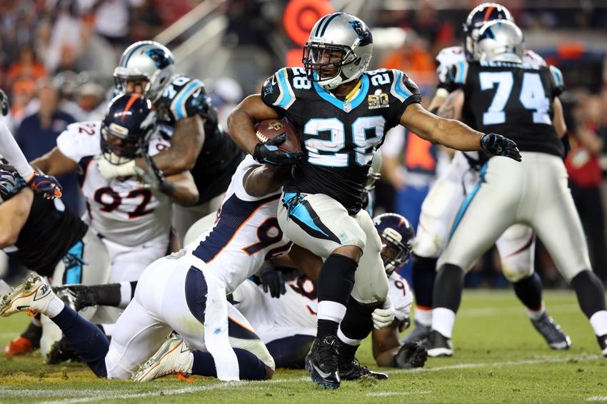 Feb 7 2016 Santa Clara Ca Usa Carolina Panthers Running Back Jonathan 28 Runs The Ball Against Denver Broncos Outside Linebacker Demarcus