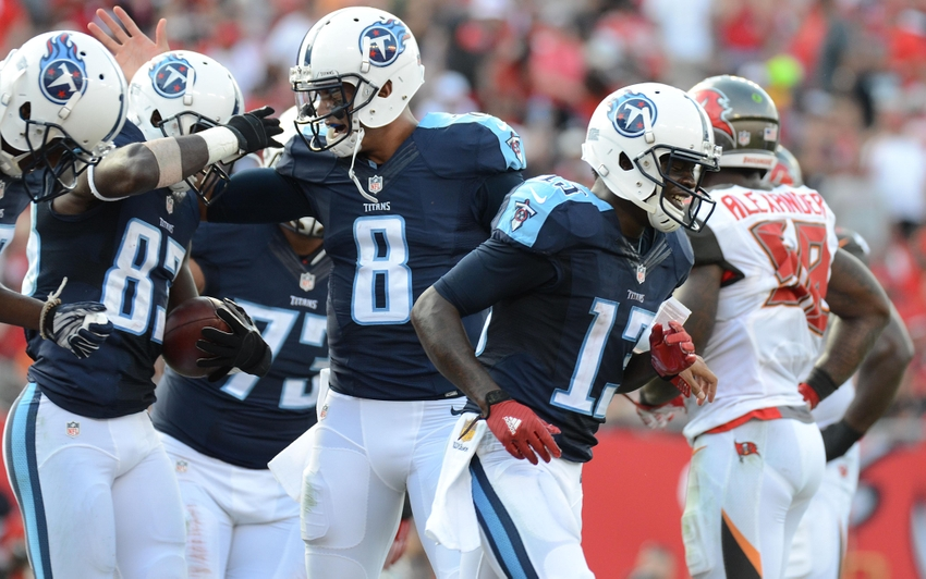 Sep 13 2015 Tampa FL USA Tennessee Titans Quarterback Marcus Mariota 8 Celebrates With Delanie Walker 83 After A Touchdown In The First Half