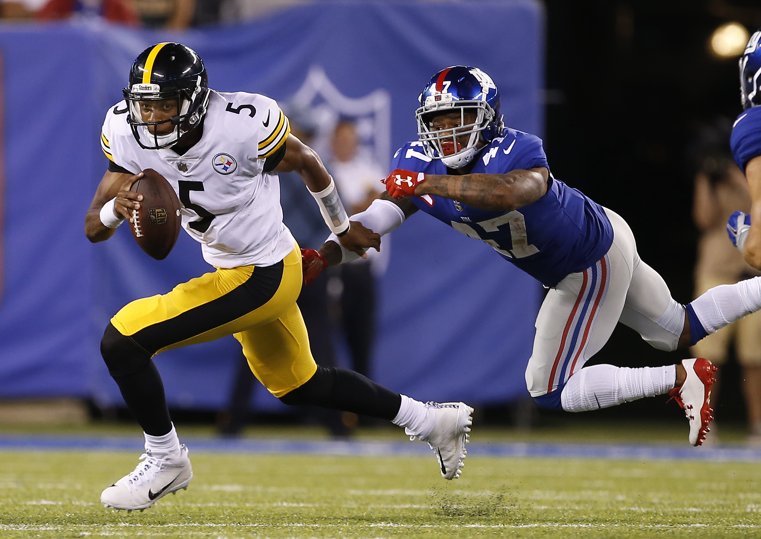 42c66a95629 ... NJ – AUGUST 11 Quarterback Joshua Dobbs 5 of the Pittsburgh Steelers  escapes Youth Nike ...