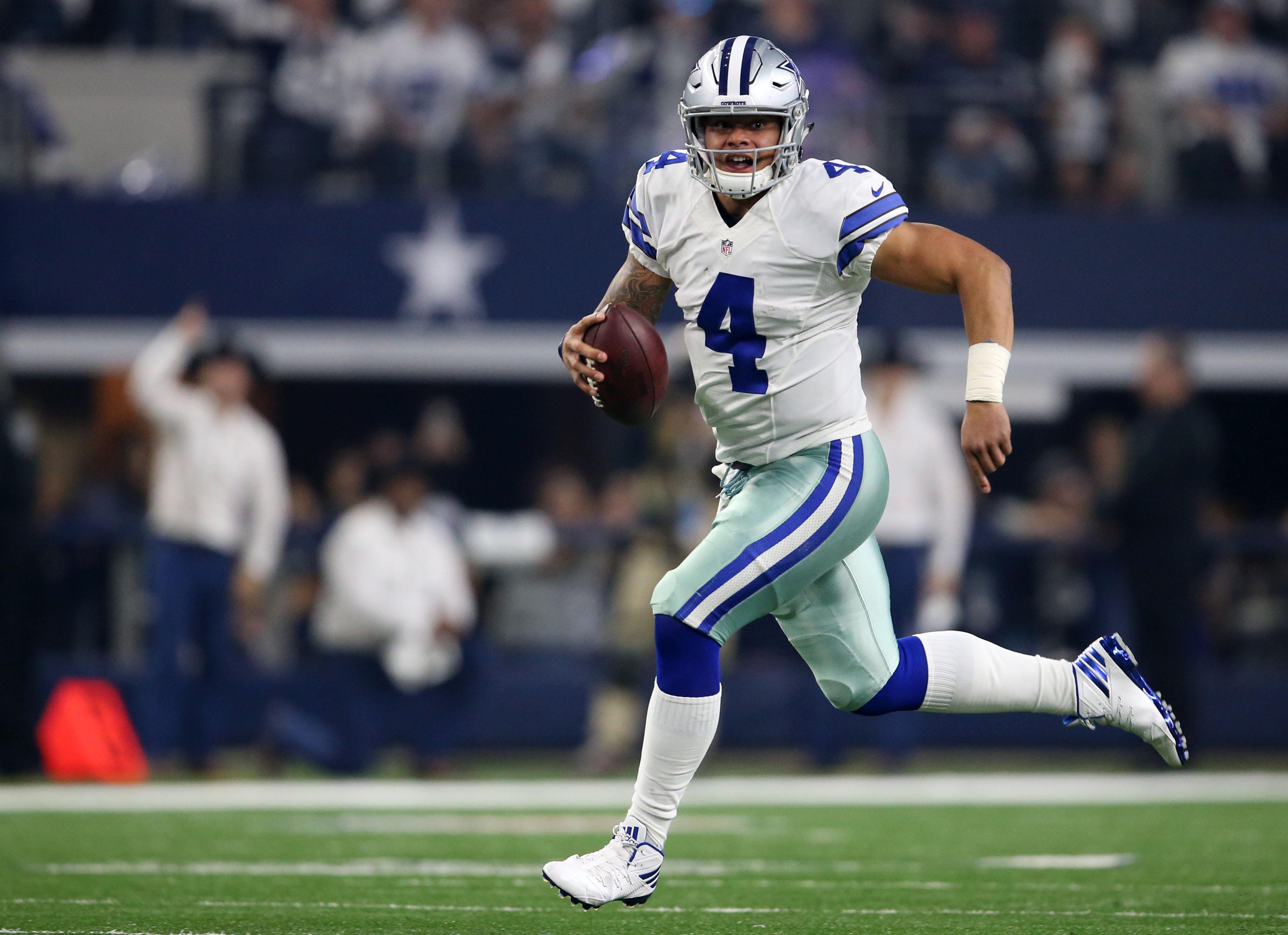 Jan 15 2017 Arlington Tx Usa Dallas Cowboys Quarterback Dak Prescott 4 Runs The Ball During Second Quarter Against Green Bay Packers In